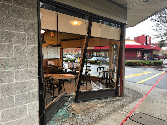 Storefront damaged as a result of a vehicle impact.