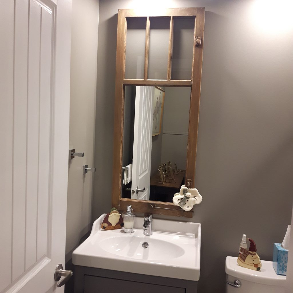 Vintage window frames converted to bathroom mirror